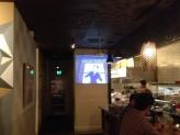 Mau restaurant on Valencia Street projecting a Max Fleischer Superman cartoon (1941) during dinner!