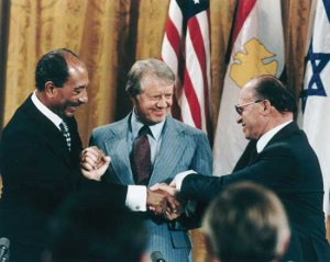 Sadat, Carter, and Begin Shake Hands